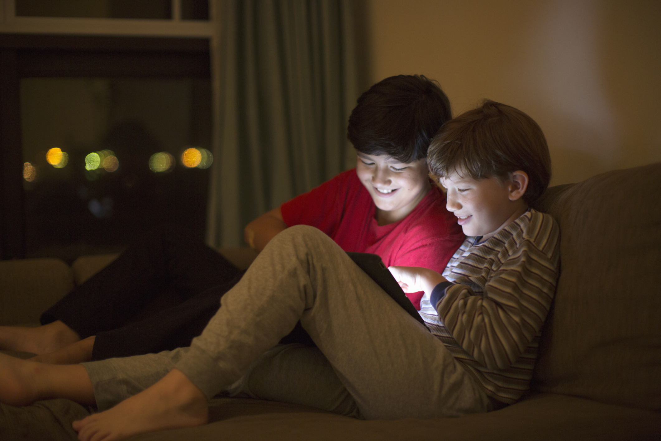 Two boys playing on an iPad
