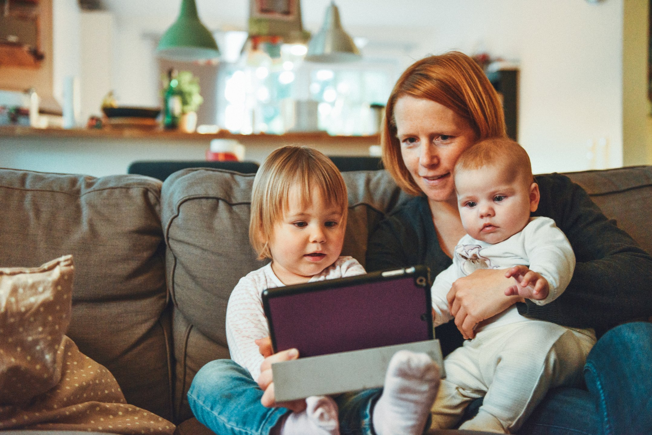 Mother and children using a tablet