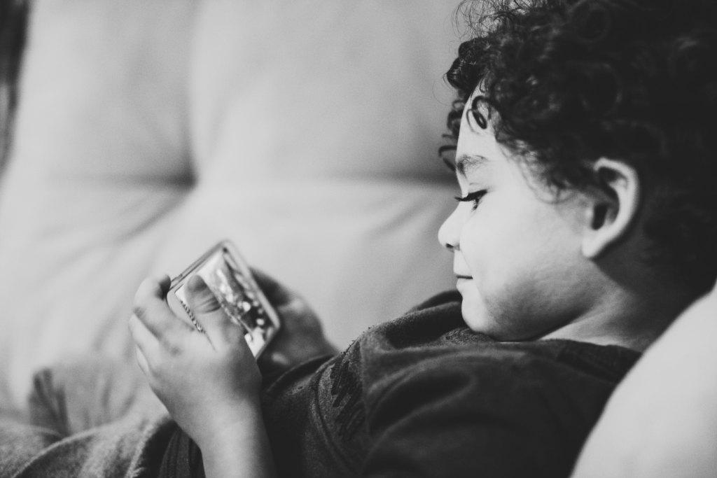 child watching a video on a smartphone